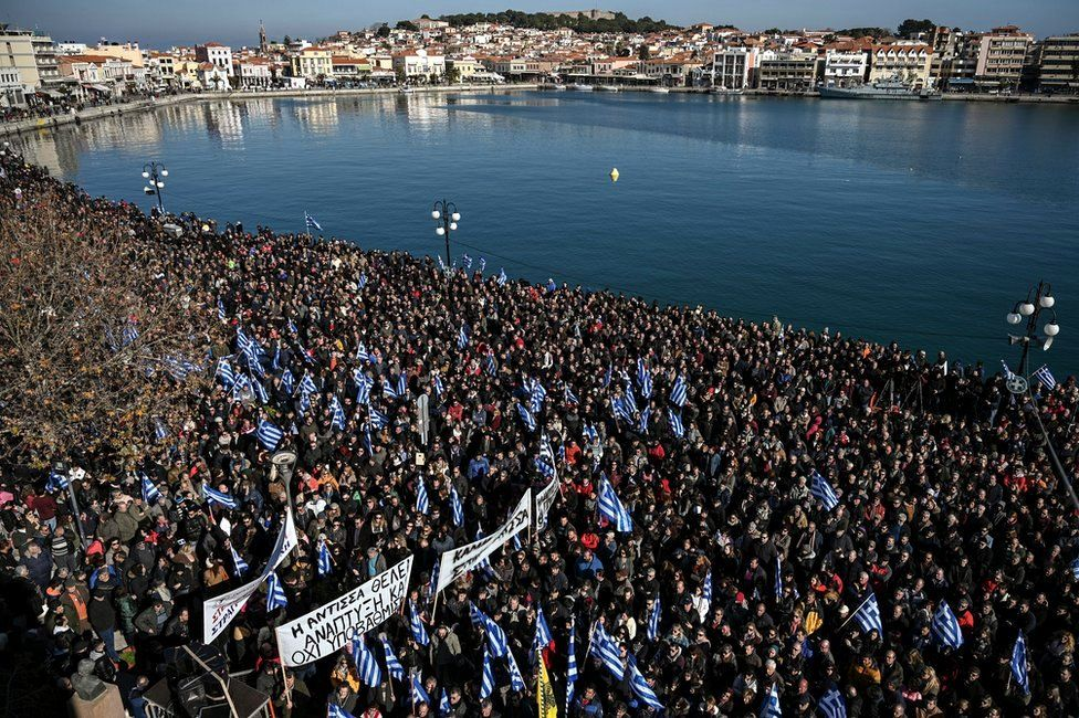 Residents of the island of Lesbos take part in a demonstration against migrant camps, at the port of Mytilene, 22 January 2020