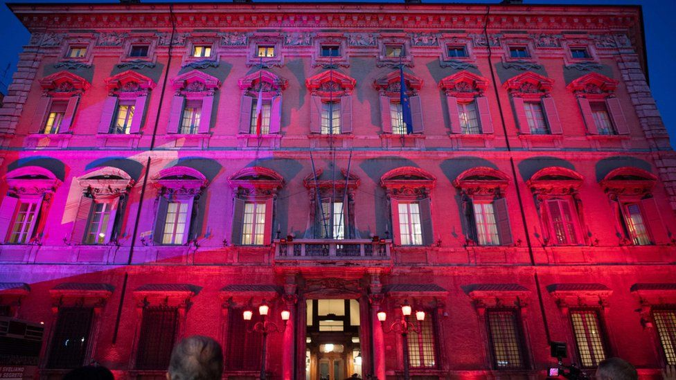 The Italian Senate building, known as Palazzo Madama, is lit in red on 25 November, 2019.