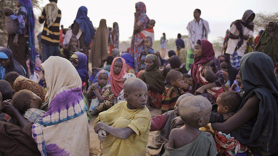 Somali refugees wait at a registration centre on August 2, 2011