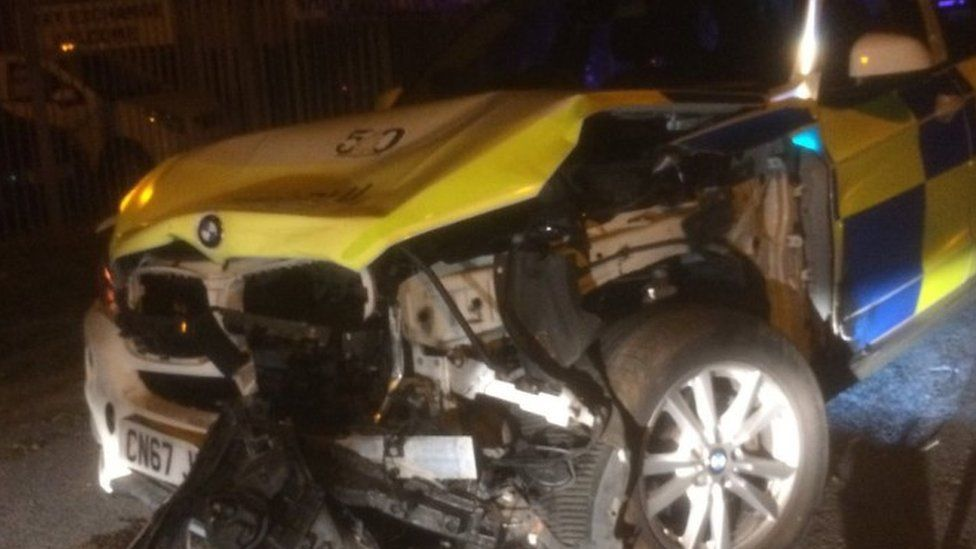Smashed police car after collision