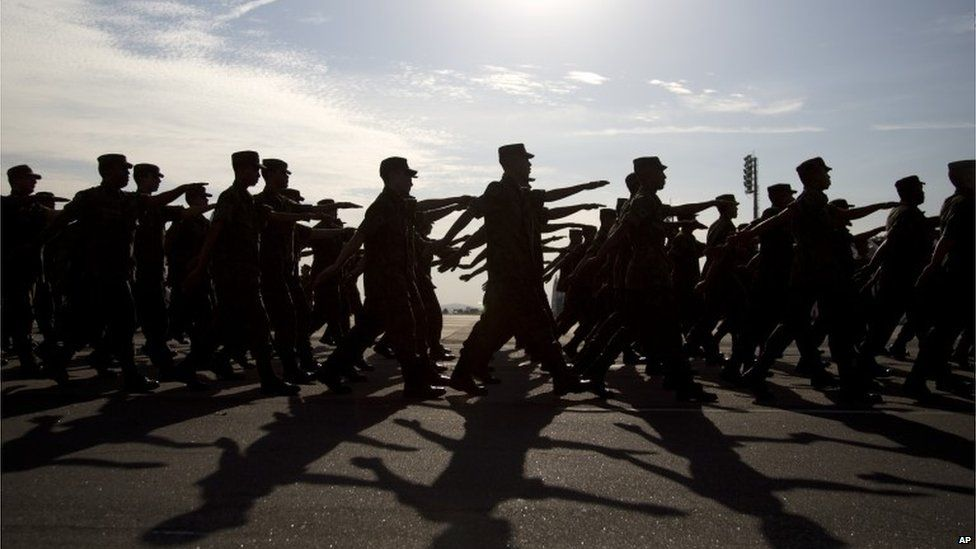 Air Force troops which will provide security for the Games march during a presentation for the press at Galeo Air Base, in Rio de Janeiro (15/07/2016)