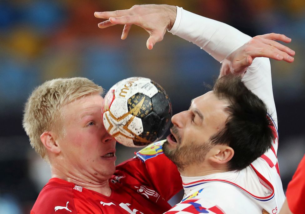 Denmark's Magnus Saugstrup clashes with Croatia's Igor Karacic at the IHF Handball World Championship in Cairo, Egypt, 25 January 2021