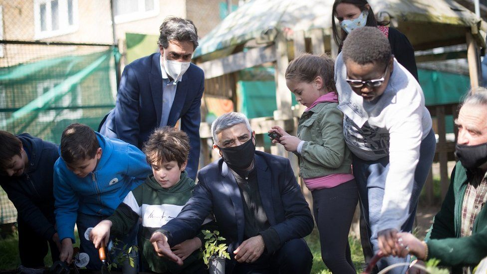 Sadiq Khan at a school garden with students