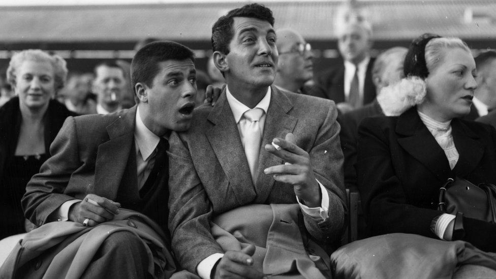 Dean Martin (born Dino Paul Crocetti 1917 - 1995), the Hollywood film star with Jerry Lewis at White City during the World Middleweight Championship of 1953