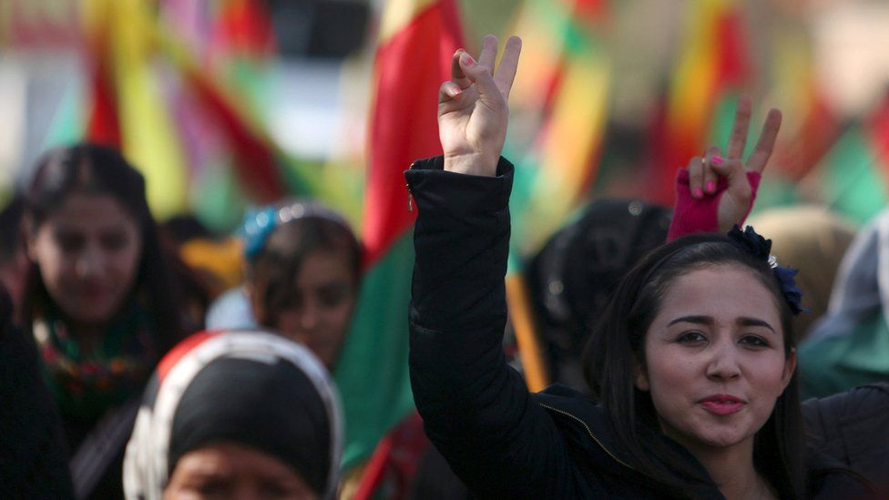 Kurdish people take part in a protest in the Syrian city of Derbasiya (9 February 2016)