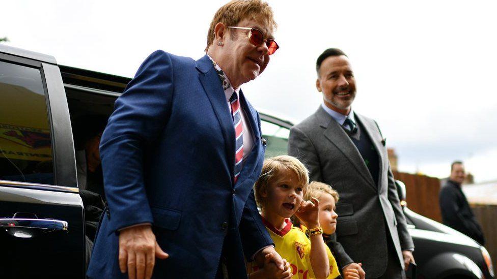 Elton John with his sons and husband David Furnish