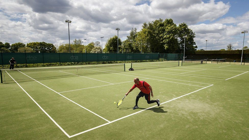 People play tennis at York Tennis Club on Wednesday