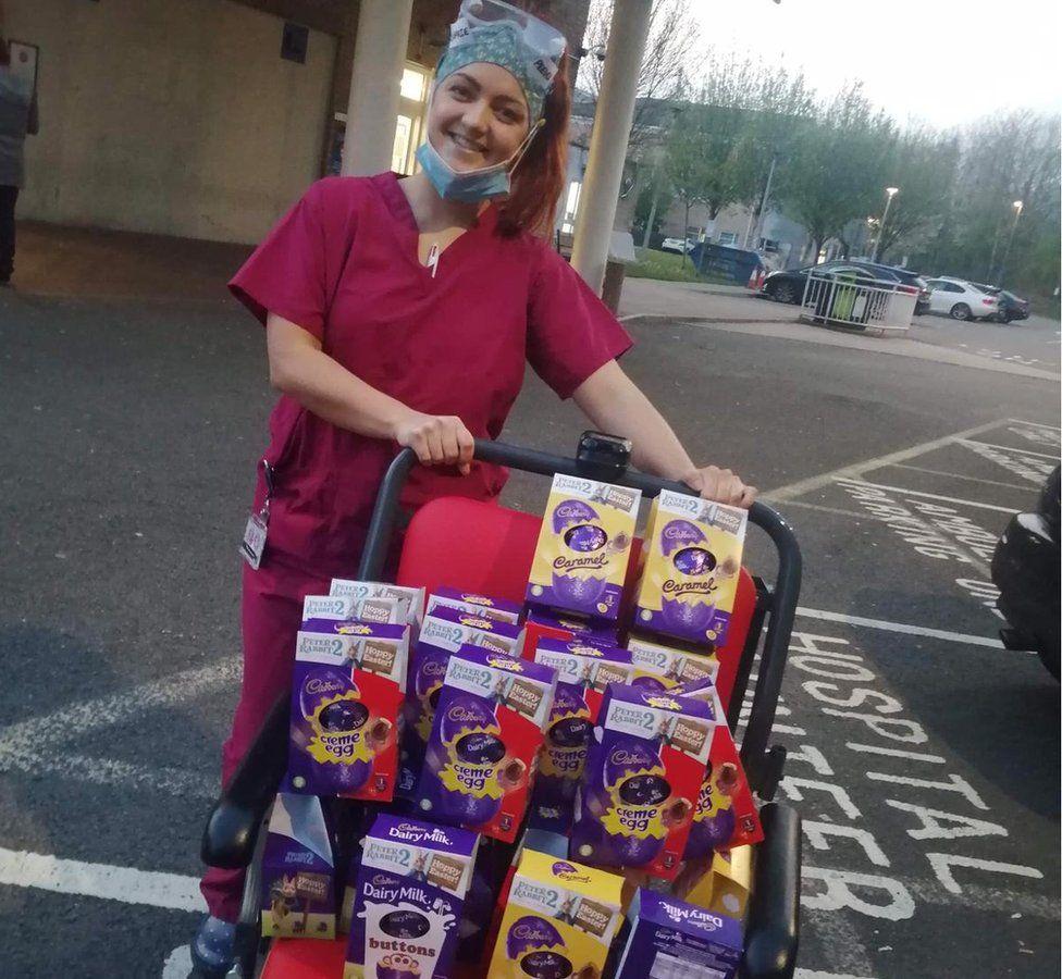 NHS staff member receiving donated Easter eggs