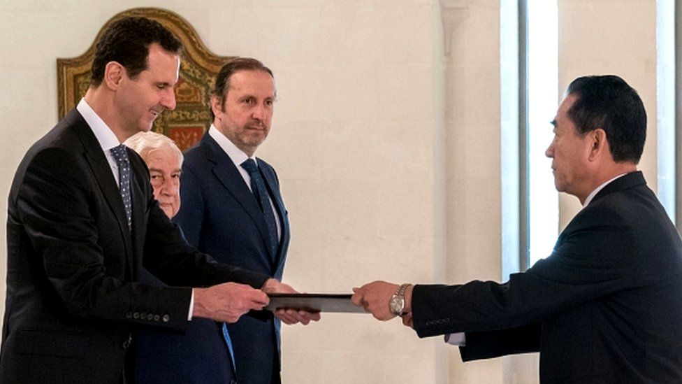 President Bashar al-Assad (left) receiving diplomatic credentials from North Korea's newly-appointed ambassador to Damascus (right), Mun Jong-nam