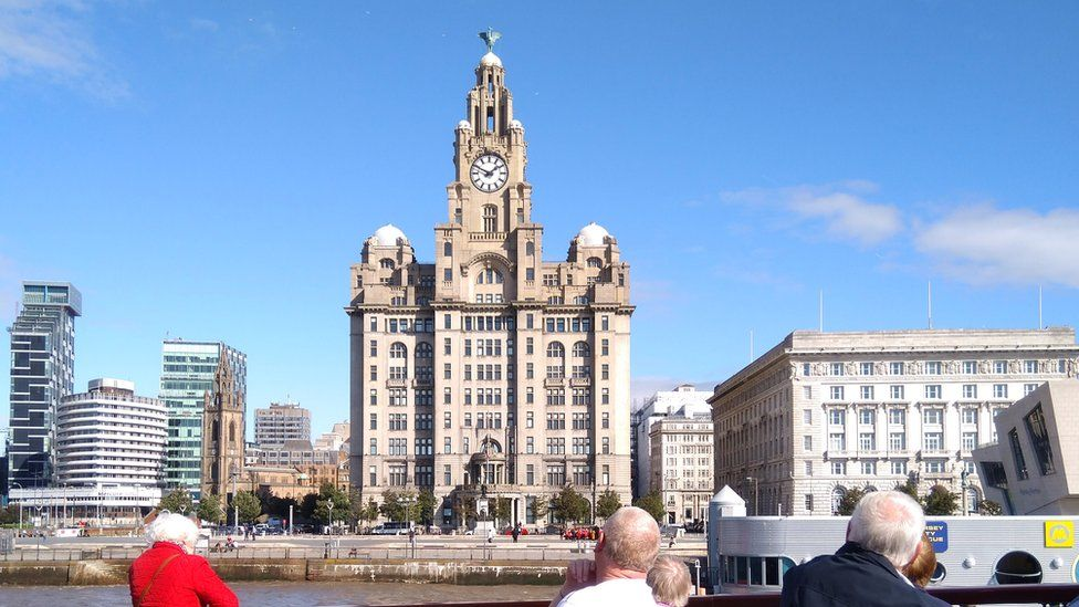 People view Liverpool waterfront from a ferry