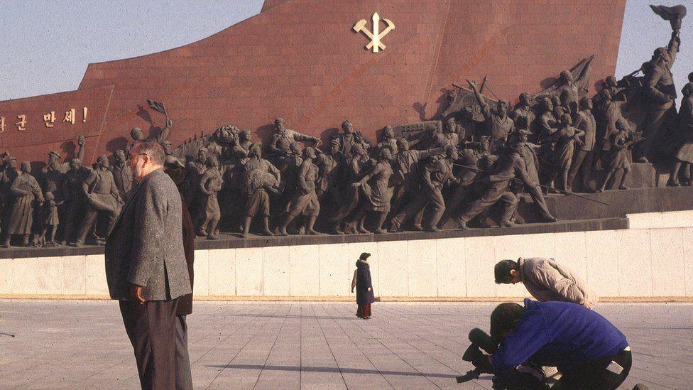 A BBC cameraman films in North Korea