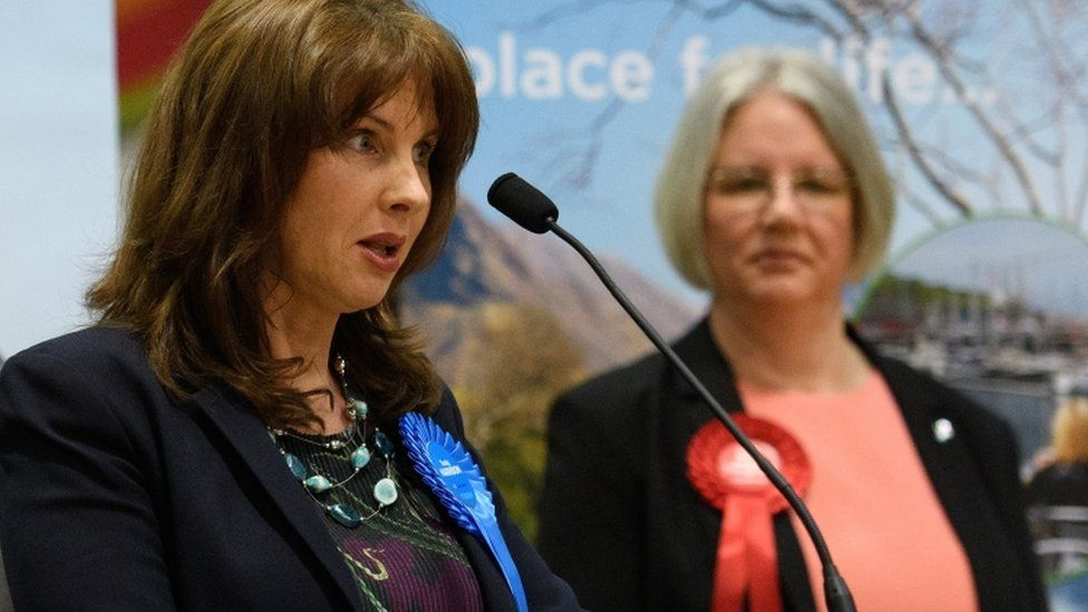Labour Party candidate Gillian Troughton (R) looks on as Conservative Party candidate Trudy Harrison speaks after winning the Copeland by-election