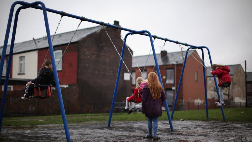 Children playing on swings in a playground