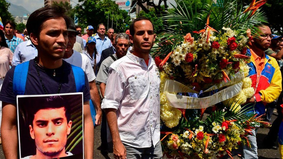 People participate in a march paying homage to student Juan Pablo Pernalete -killed on the eve by impact of a gas grenade during a protest against President Nicolas Maduro- in Caracas, on April 27, 2017