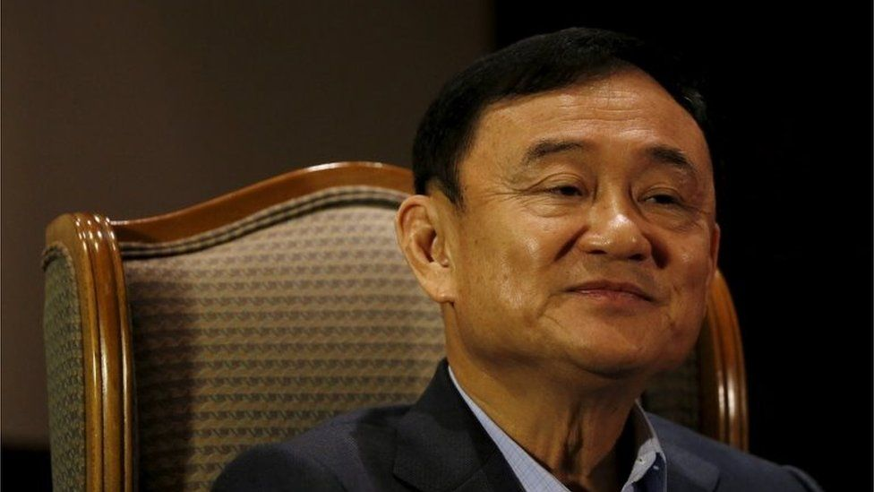 Former Thai Prime Minister Thaksin Shinawatra looks on as he speaks to Reuters during an interview in Singapore February 23, 2016.
