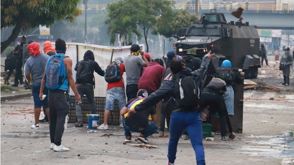 """Demonstrators clash with members of the security forces during a protest against what they say was police brutality exerted in recent protests against President Ivan Duque""""s government""""s tax reform in Cali, Colombia May 3, 2021."""