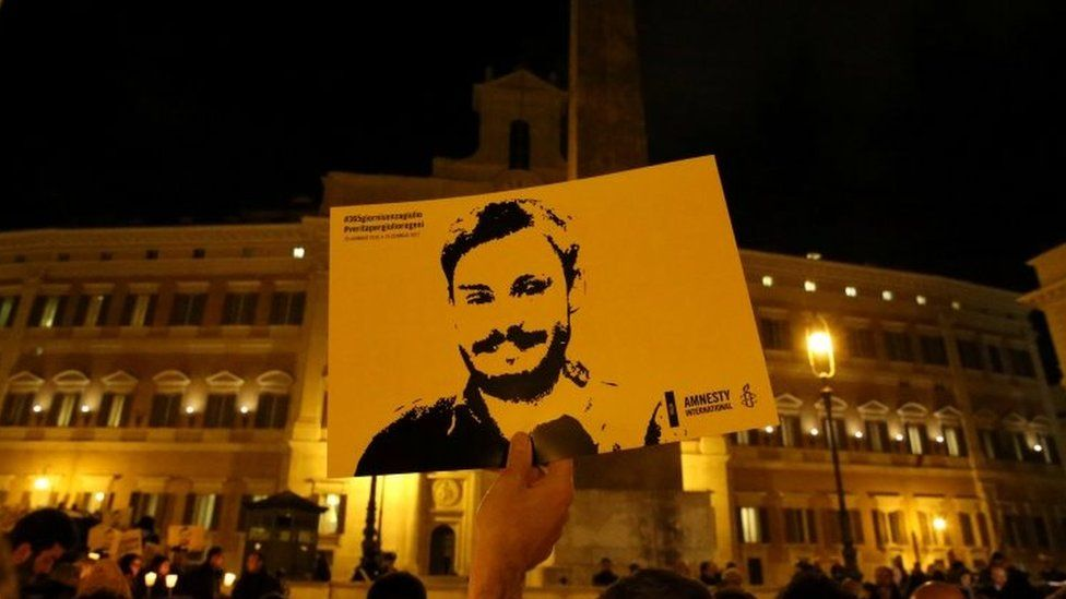 Demonstration on second anniversary, someone holds an image of Regeni