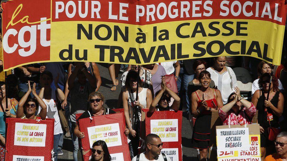 Women attend a demonstration in Marseille