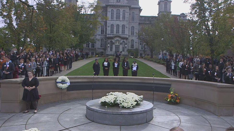 rose laying ceremony at Syracuse University