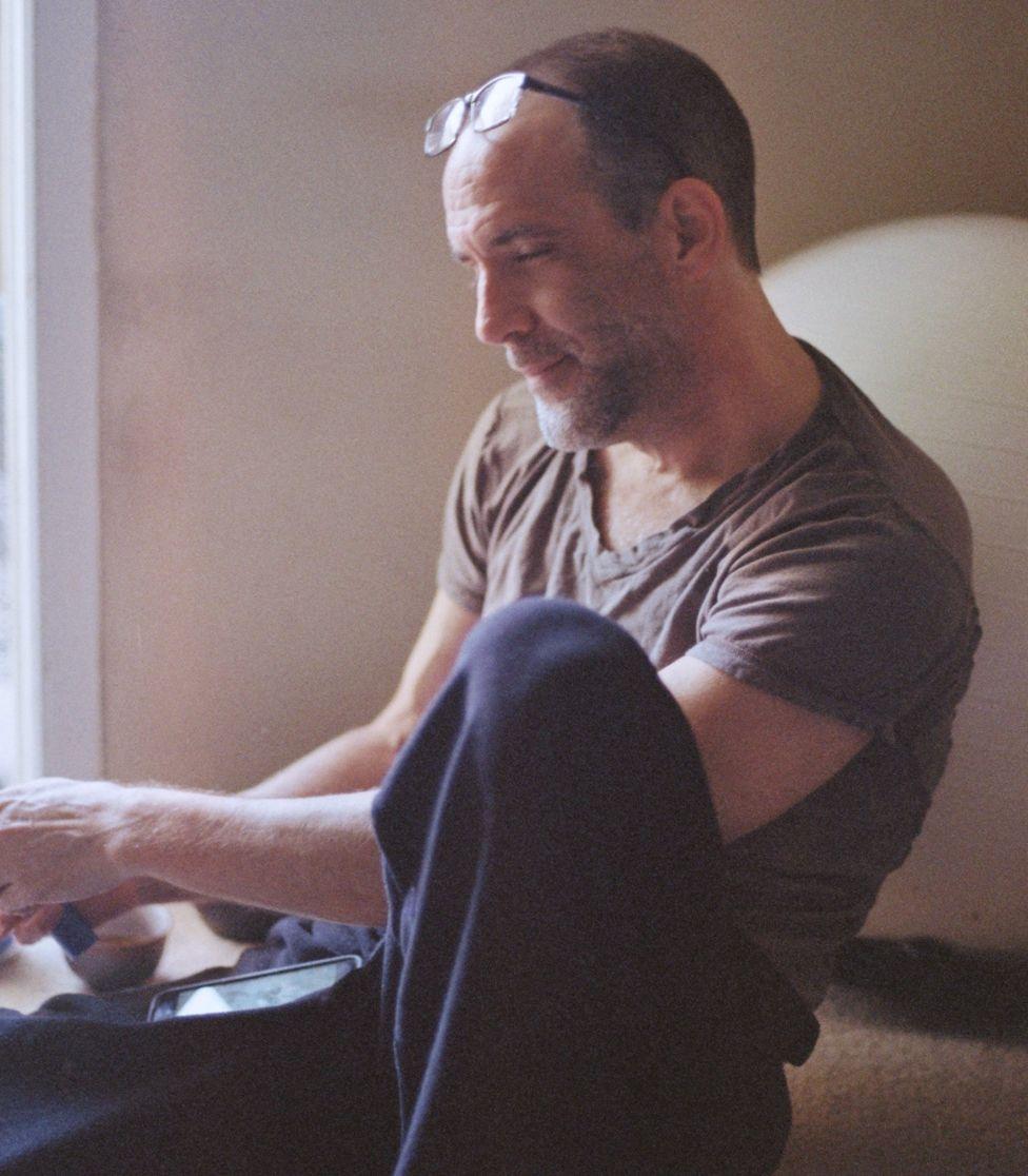Michael Van Huffel in his apartment