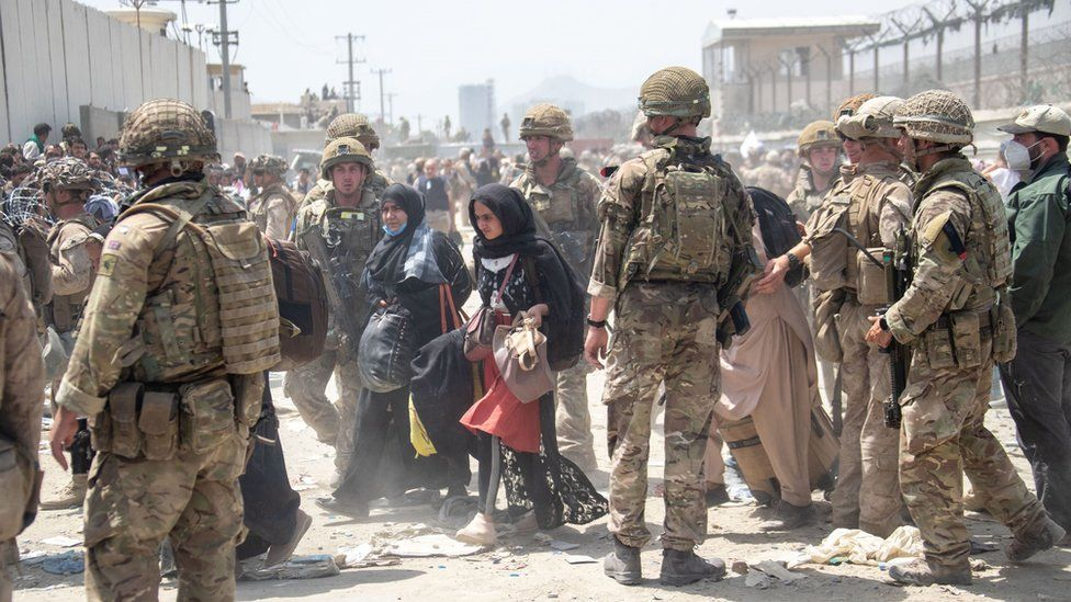 Members of the British and US military engaged in the evacuation of people out of Kabul