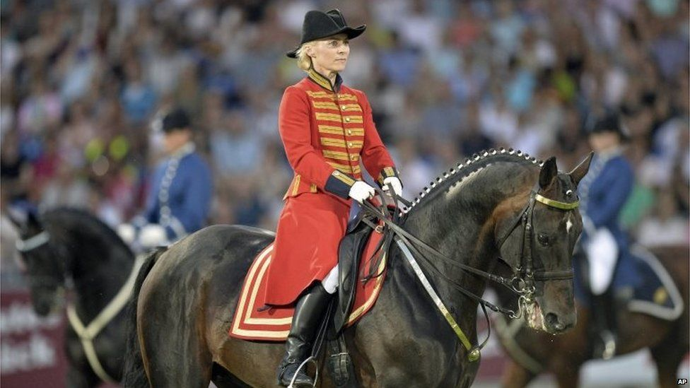Ursula von der Leyen rides on a horse during the opening ceremony of the FEI European Championships in Aachen, Germany (Aug. 11, 2015)