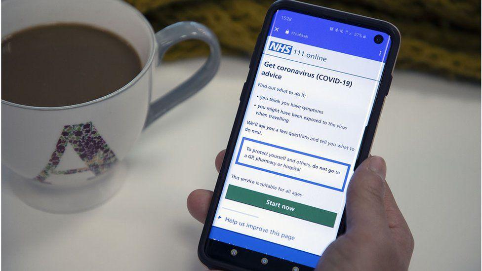 NHS coronavirus checker on a mobile phone