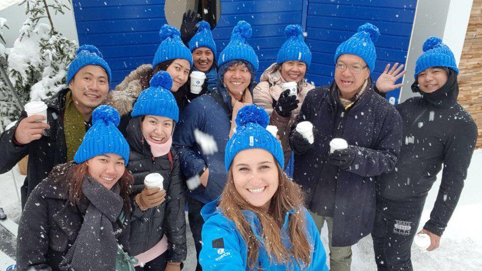 People wearing blue Zurich Insurance bobble hats
