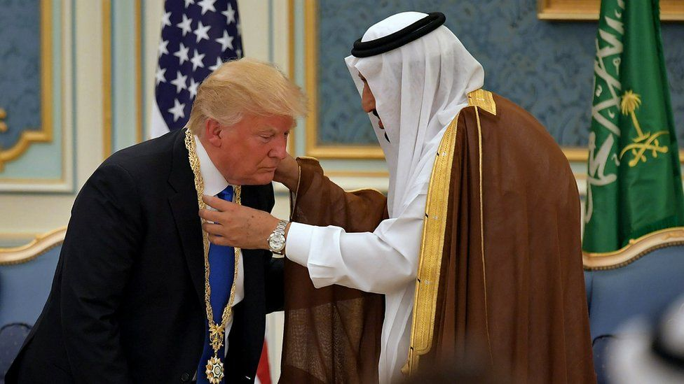 President Donald Trump receives the Order of Abdulaziz al-Saud medal from Saudi Arabia's King Salman bin Abdulaziz al-Saud at the Saudi Royal Court in Riyadh.