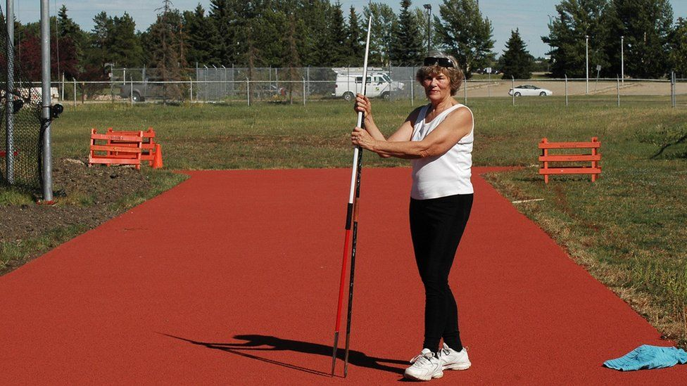 Margaret Tosh is seen in a field at a javelin throw practice.
