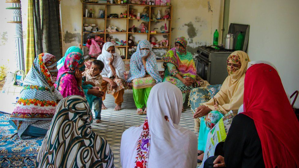 Women at 'Iram's' house learning about the election process