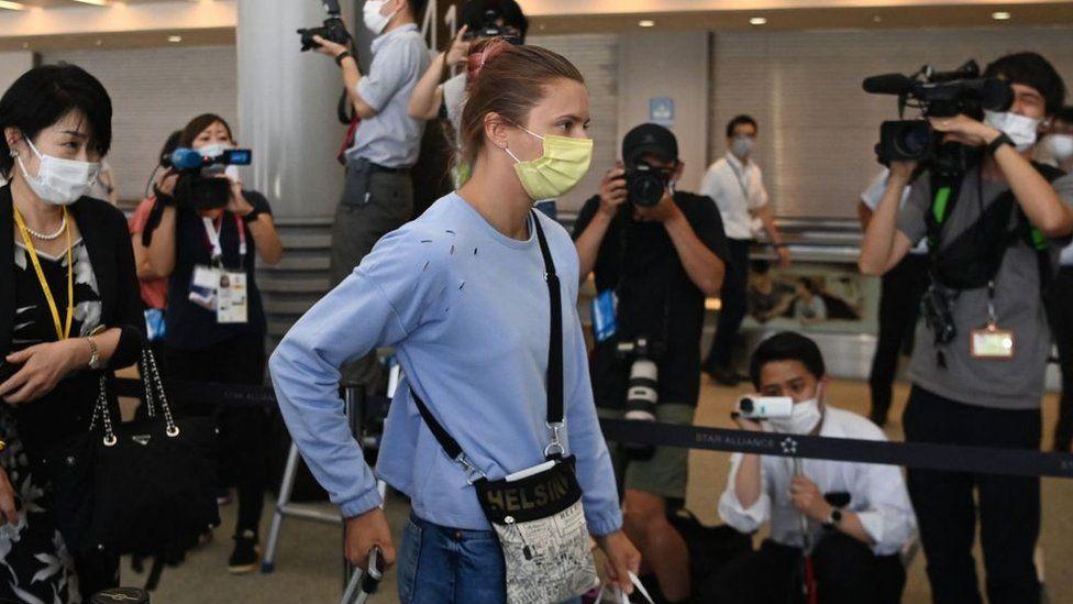 Krystina Timanovskaya walks with her luggage inside the airport