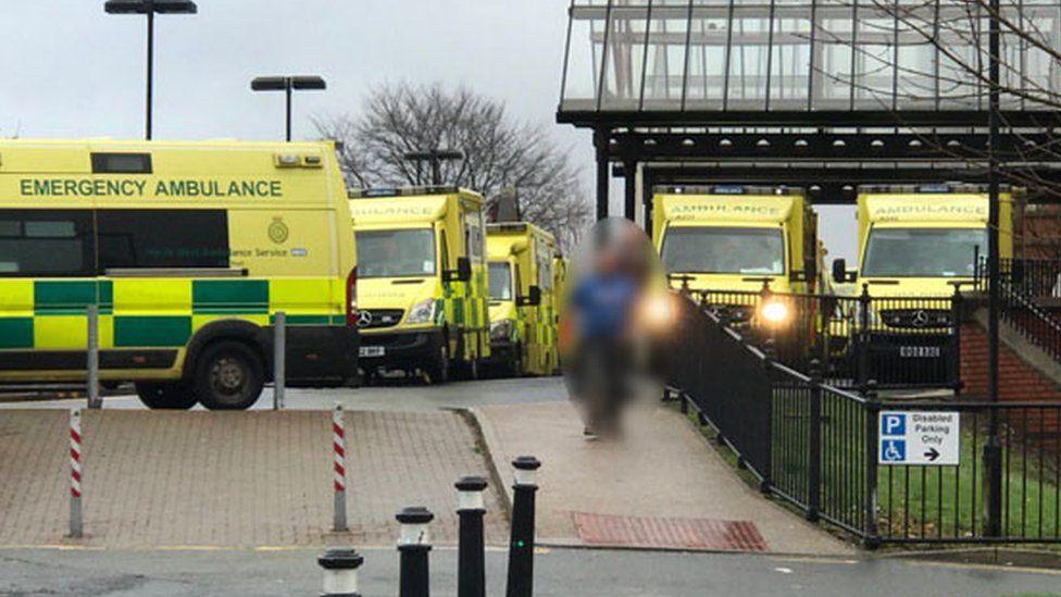 Ambulances queuing at a hospital in Wigan