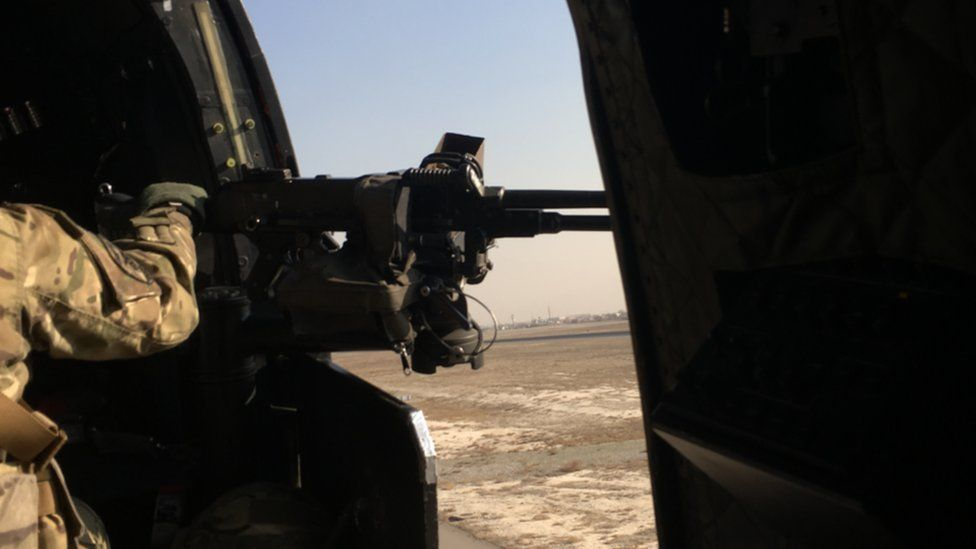 Being transported in Afghanistan by helicopter