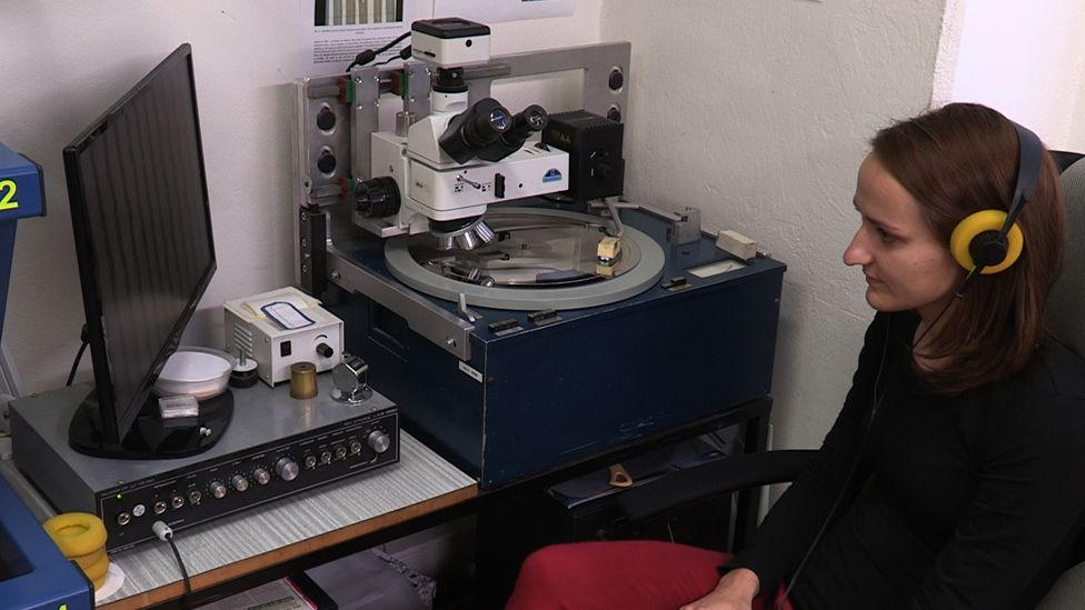 A member of GZ staff listening to a record