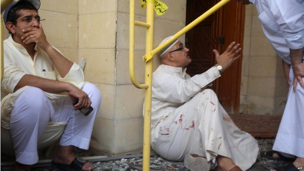 Kuwaiti men react at the site of a suicide bombing that targeted the Shia Al-Imam al-Sadeq mosque during Friday prayers on 26 June 2015, in Kuwait City