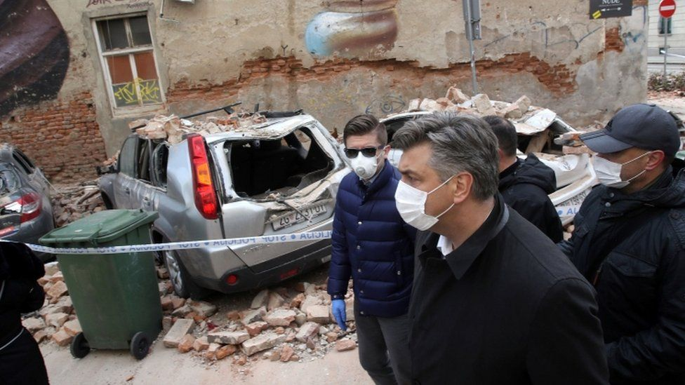 Croatian Prime Minister Andrej Plenkovic looks at the damage from the earthquake