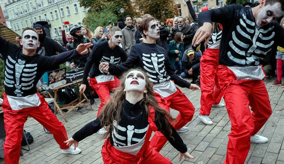 Participants dressed as zombies take part in a Zombie Walk parade