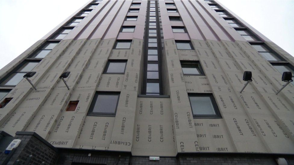 A tower block in Salford where some of the unsafe cladding has been removed