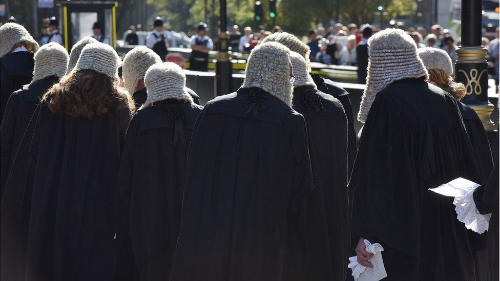 barristers in gowns and wigs