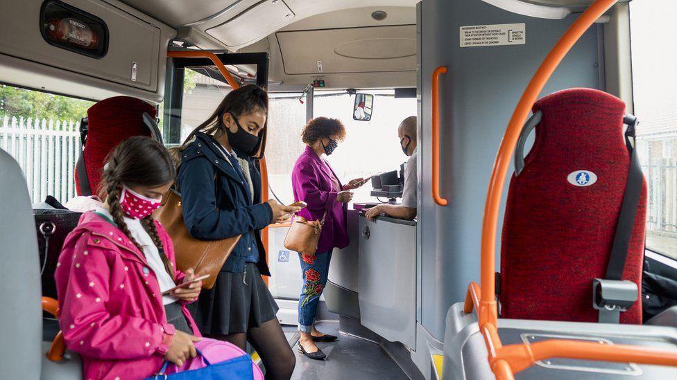 Masked passengers on bus