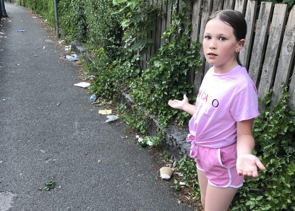 Kylah upset over the litter near her home