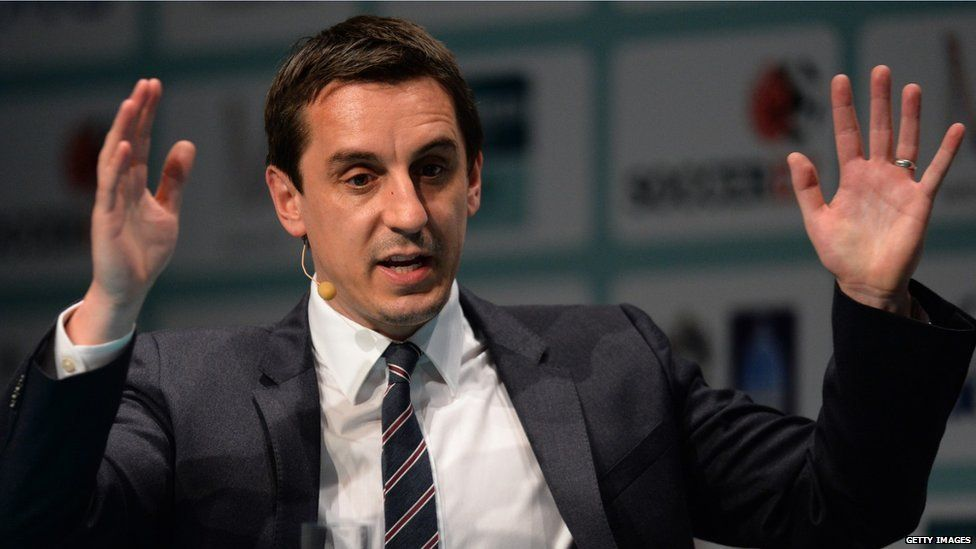 Gary Neville speaks at a football business convention