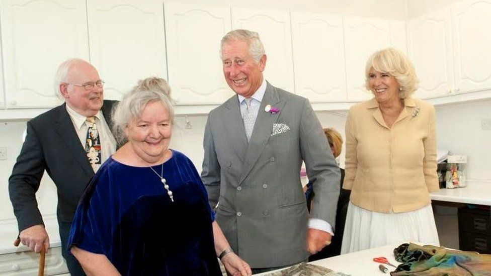 Prince Charles and the Duchess of Cornwall visit Patricia and Charles Lester at their fashion studio in Abergavenny, Monmouthshire
