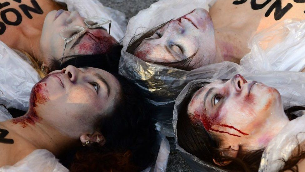 Women in Spain dressed up as corpses to protest against rising rates of femicide