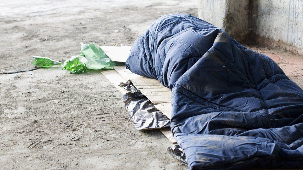 Homeless person sleeping rough