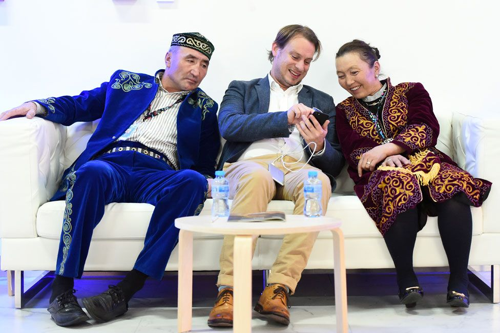 Otto Bell (centre) with Aisholpan's parents, Agalai (right) and Almagul