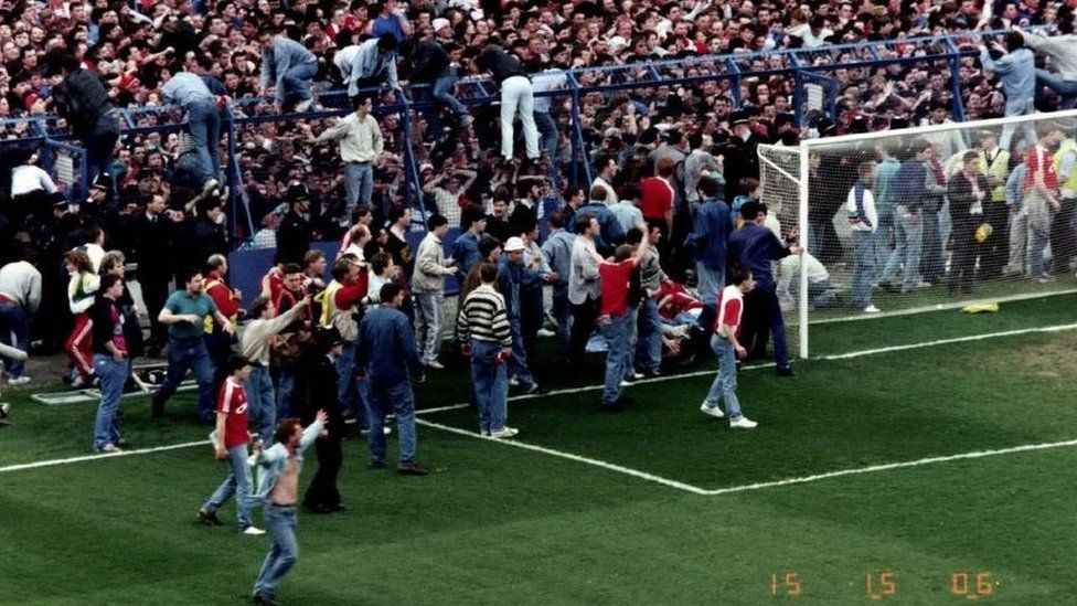 Liverpool fans escaping packed pens at Hillsborough