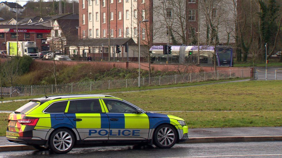Police car and a Glider in west Belfast
