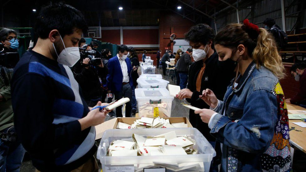 Chilean citizens count the votes at the end of the electoral day during the Constitutional Convention Election